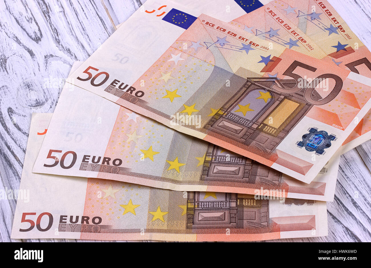 Fifty euro banknotes on white wooden background. - Stock Image