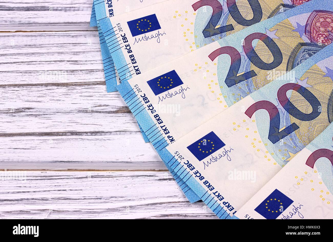 Twenty euro banknotes on white wooden background. - Stock Image