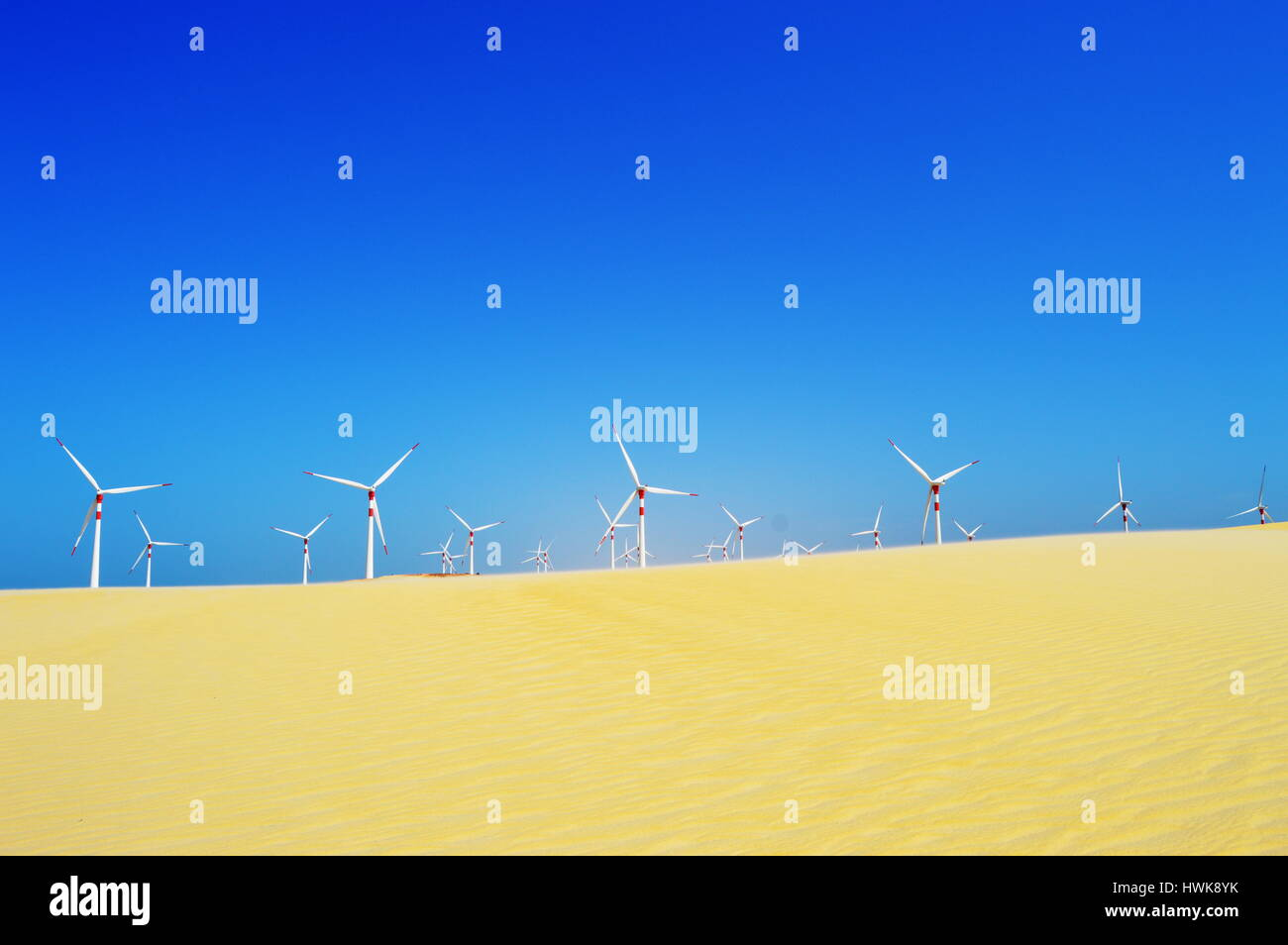 Wind turbines at the dunes on a sunny day Stock Photo
