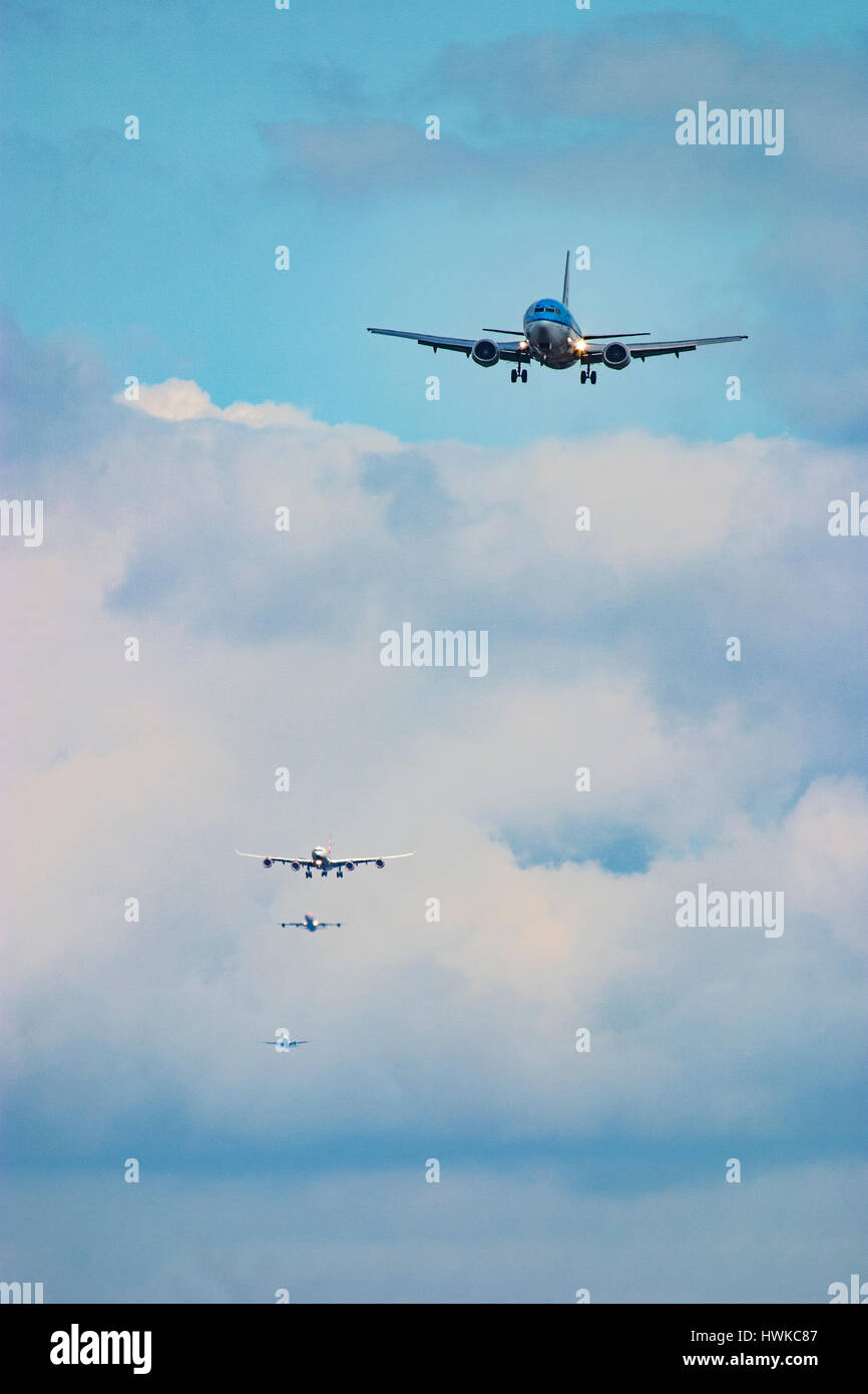 Commercial airplanes landing at London Heathrow Airport, UK - Stock Image