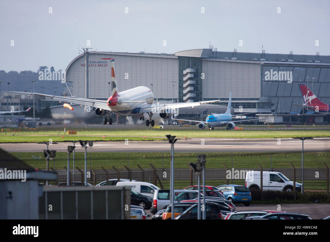 British Airways  Airbus A319 landing at London Heathrow Airport, UK - Stock Image