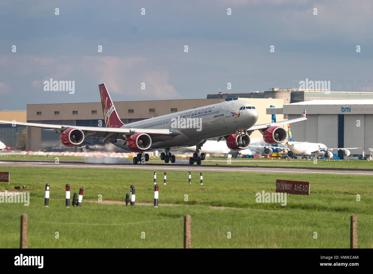 Virgin Atlantic Airbus A340 touching down at London Heathrow Airport, UK - Stock Image