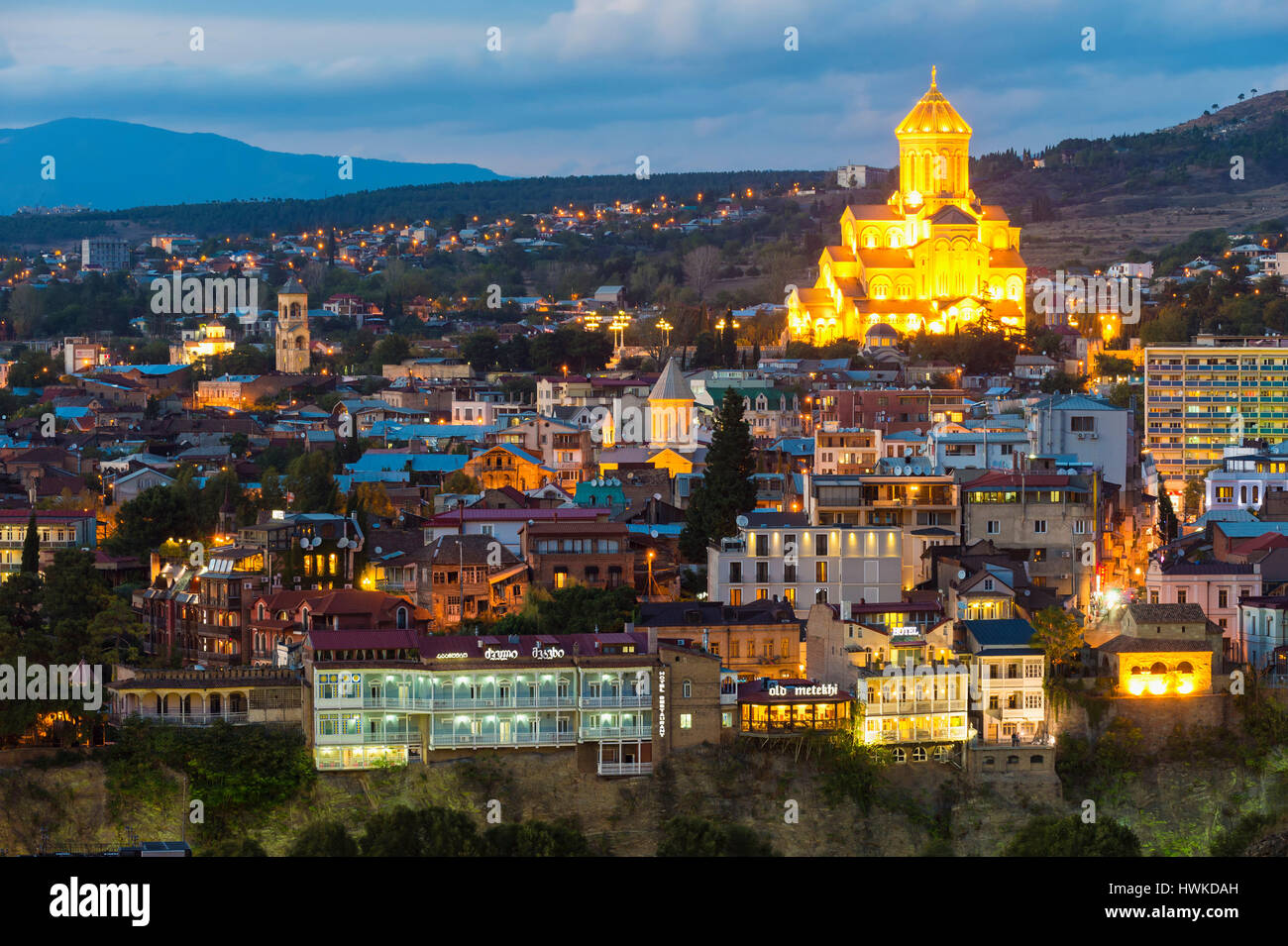 Holy Trinity Cathedral and Tbilisi at night, Georgia, Caucasus, Middle East, Asia Stock Photo
