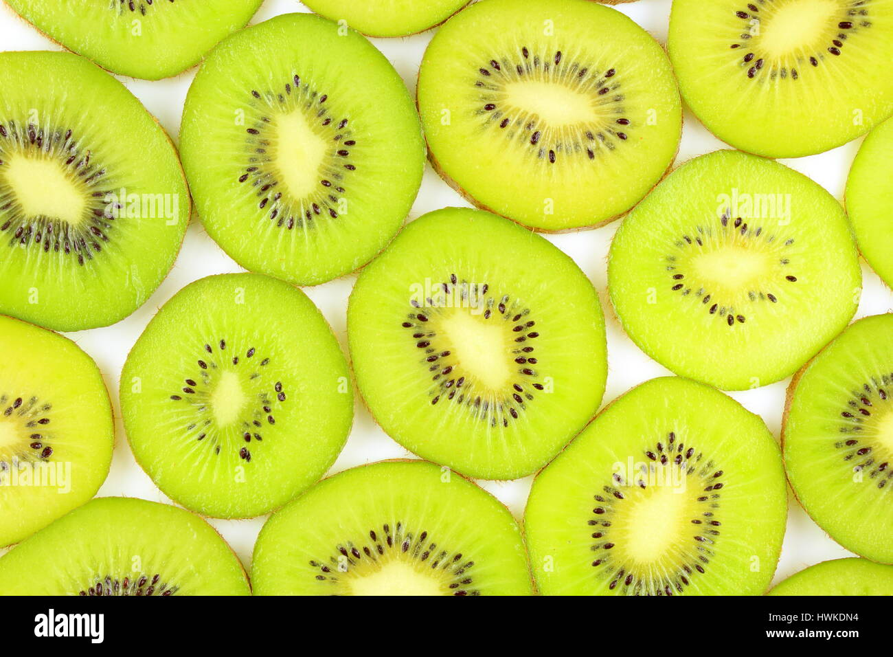 slices of fresh green kiwi fruits as a food background texture Stock Photo