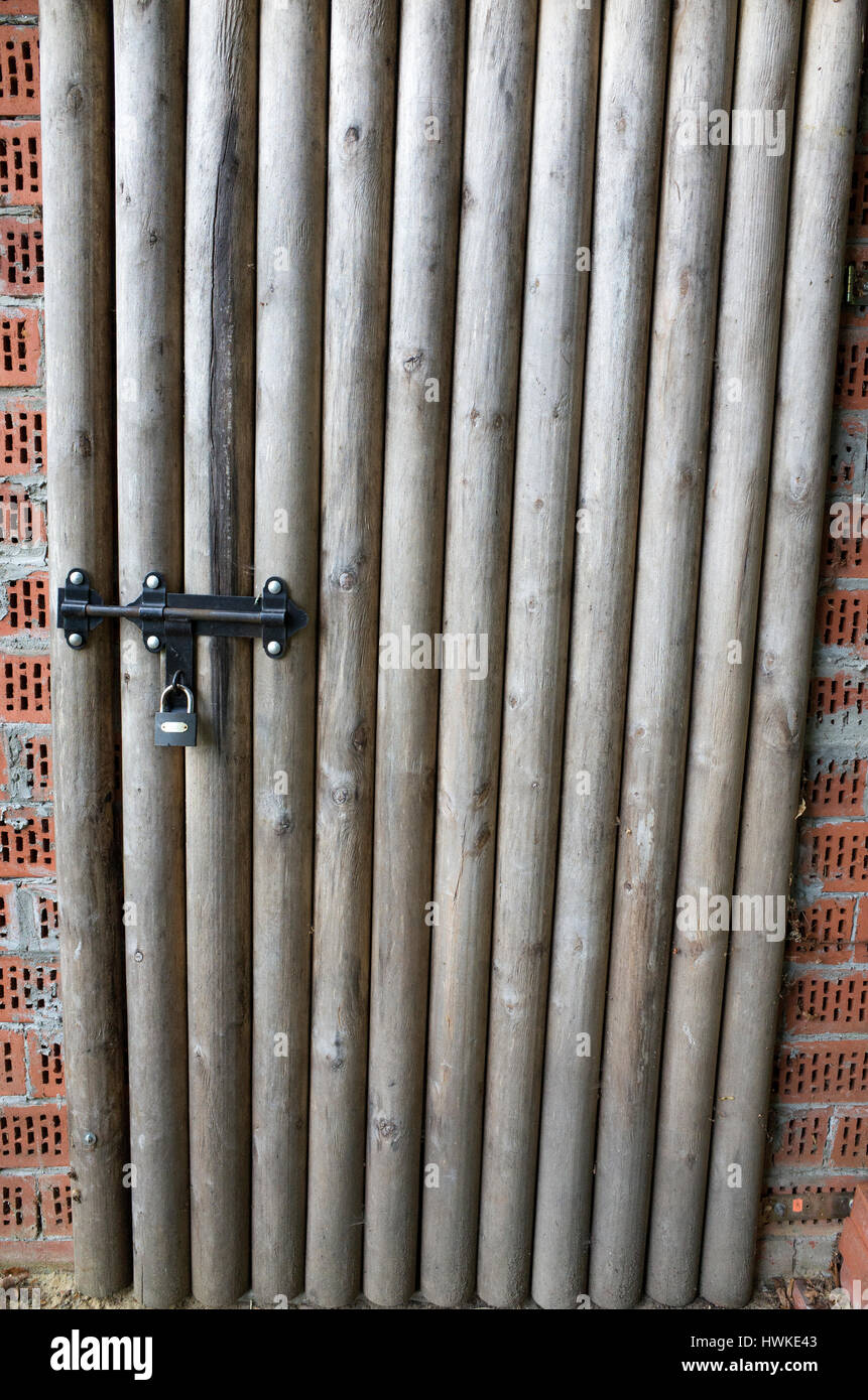Wooden shed door secured with padlock and bolt lock. Zawady Central Poland Europe - Stock Image