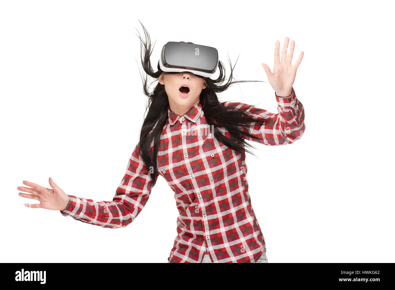 Shocked woman with opened mouth traveling in cyberspace. - Stock Image