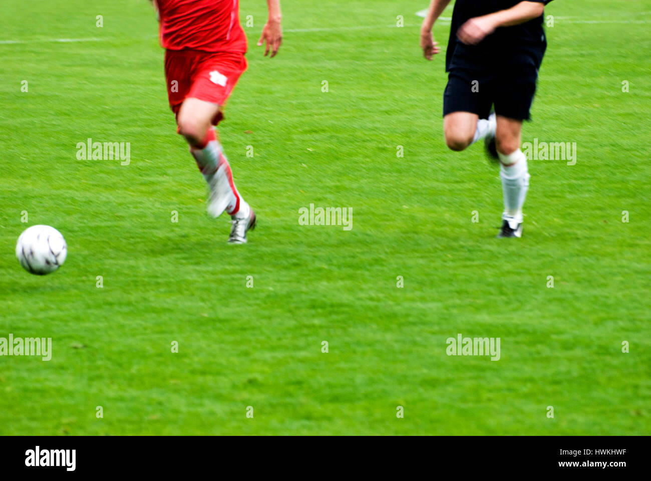 soccer or football players in action during a game - Stock Image