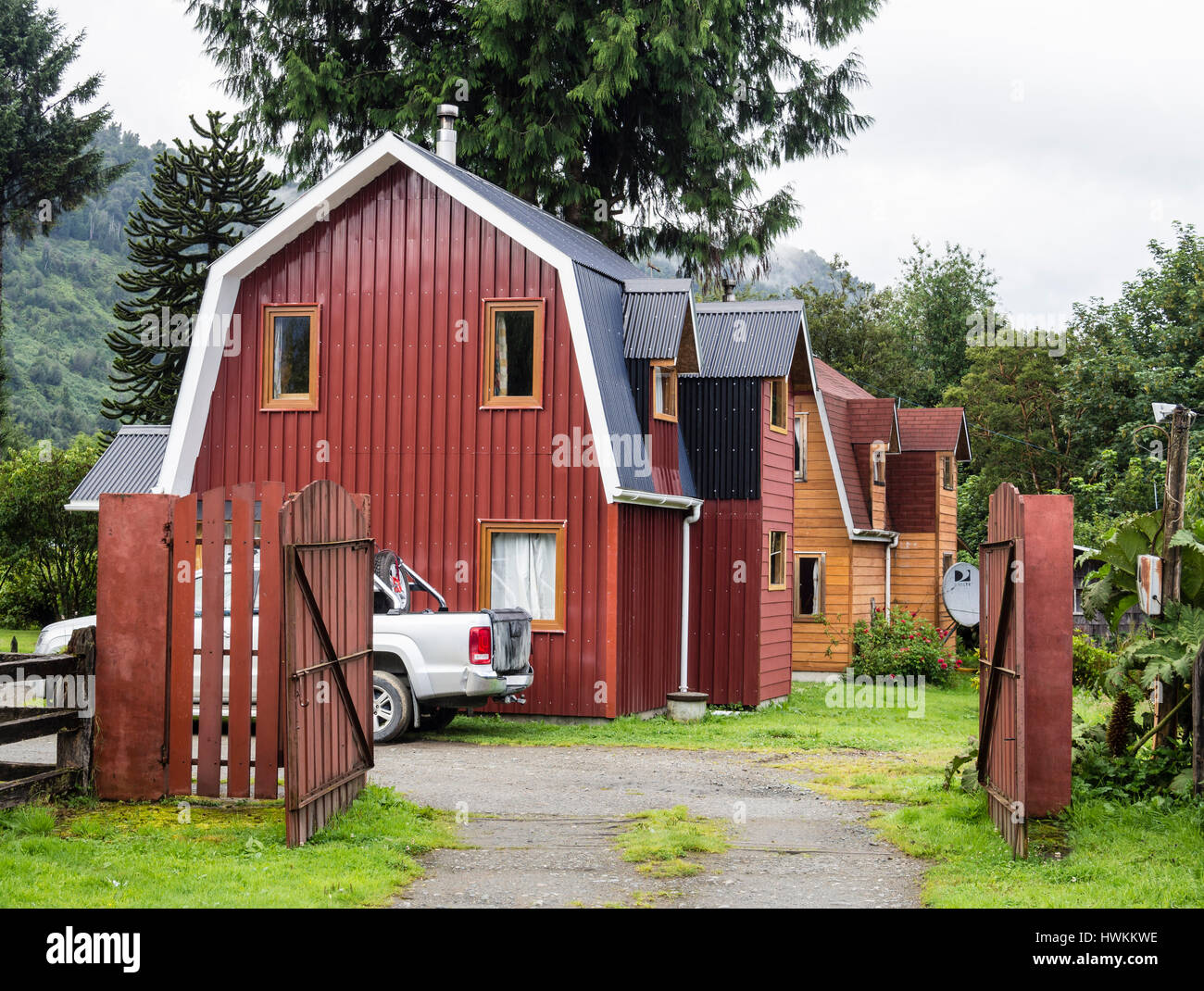 Traditional wooden houses, Puyuhuapi, at road Carretera Austral,  Patagonia, Chile - Stock Image