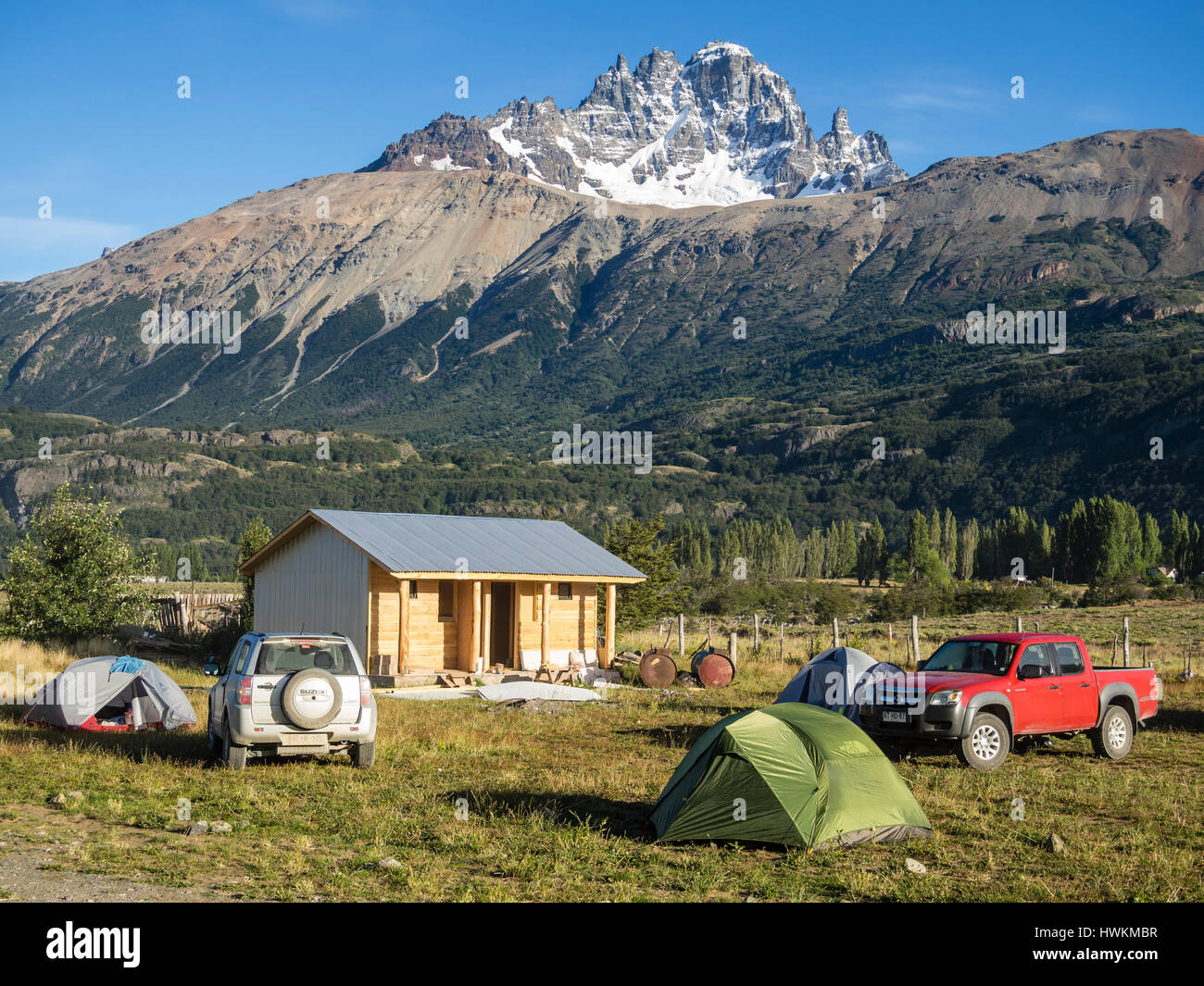 Tents on campsite in village Villa Cerro Castillo , mountain Cerro Castillo in the backg, Aysen region, Patagonia, - Stock Image