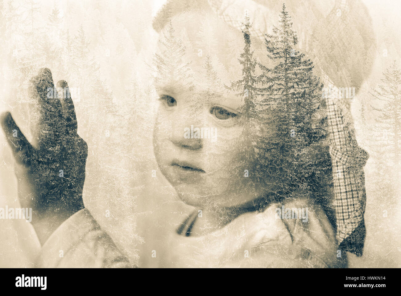 Little boy daydreaming, looking out the window at nature, thinking about it. Double exposure of child portrait and - Stock Image