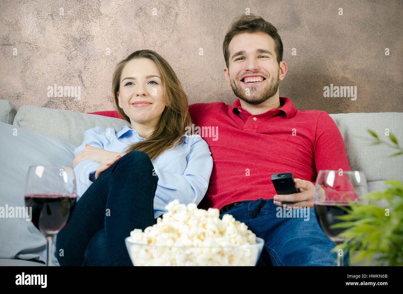 Couple enjoys free time and watching tv  couple watching