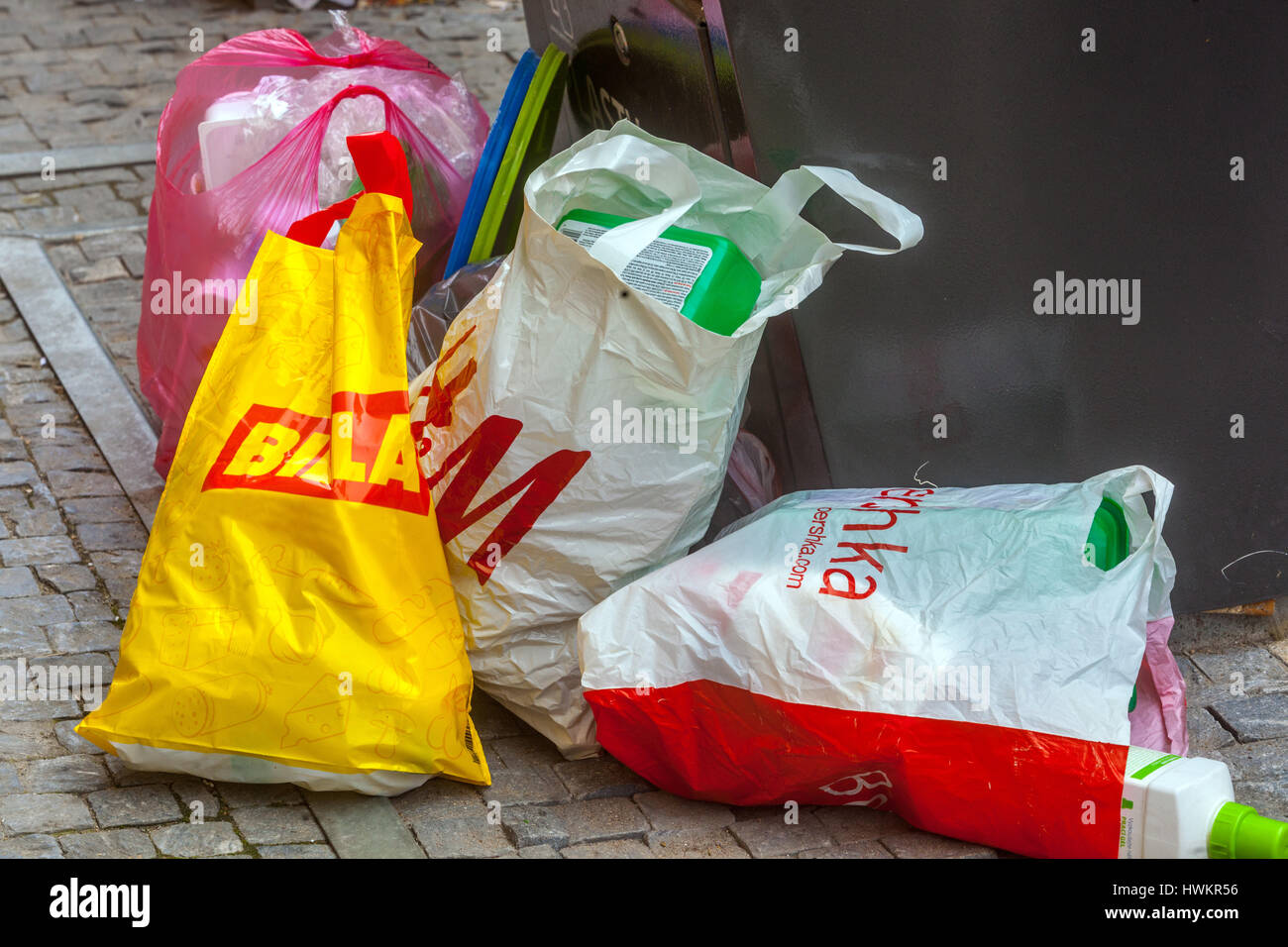 Rubbish waste plastic bags at bin, Shopping bags - Stock Image