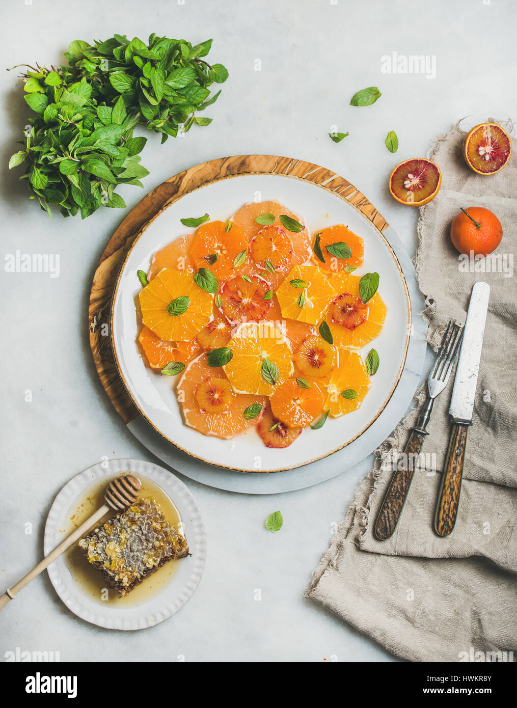 Vegan Fresh mixed citrus fruit salad with mint and honey - Stock Image