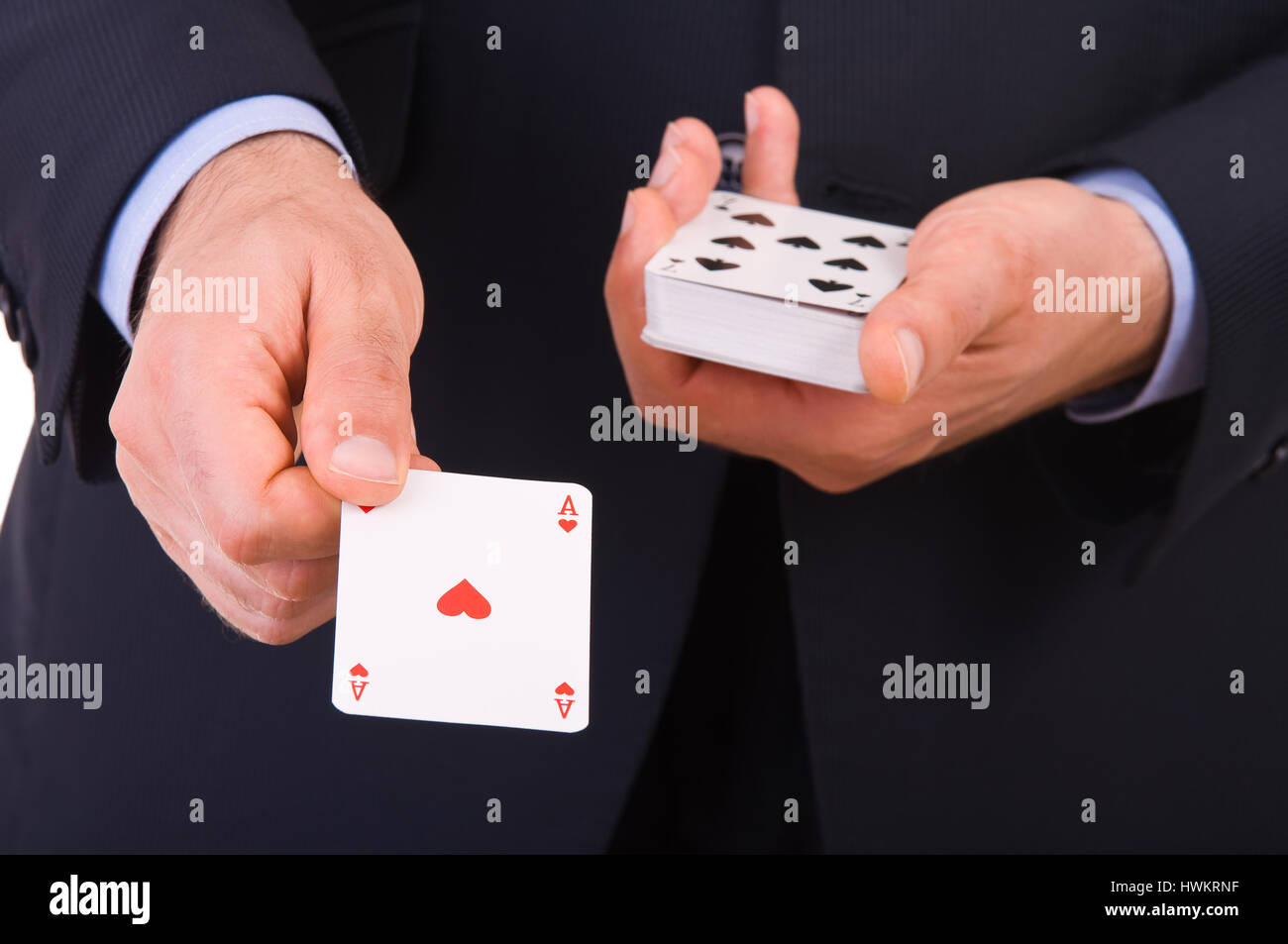 Businessman showing playing cards. - Stock Image