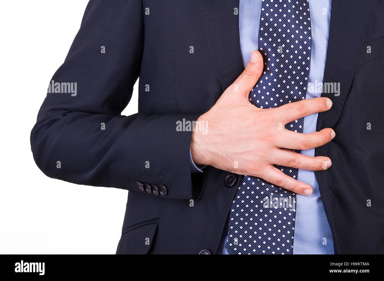 Businessman suffering from heartburn. - Stock Image