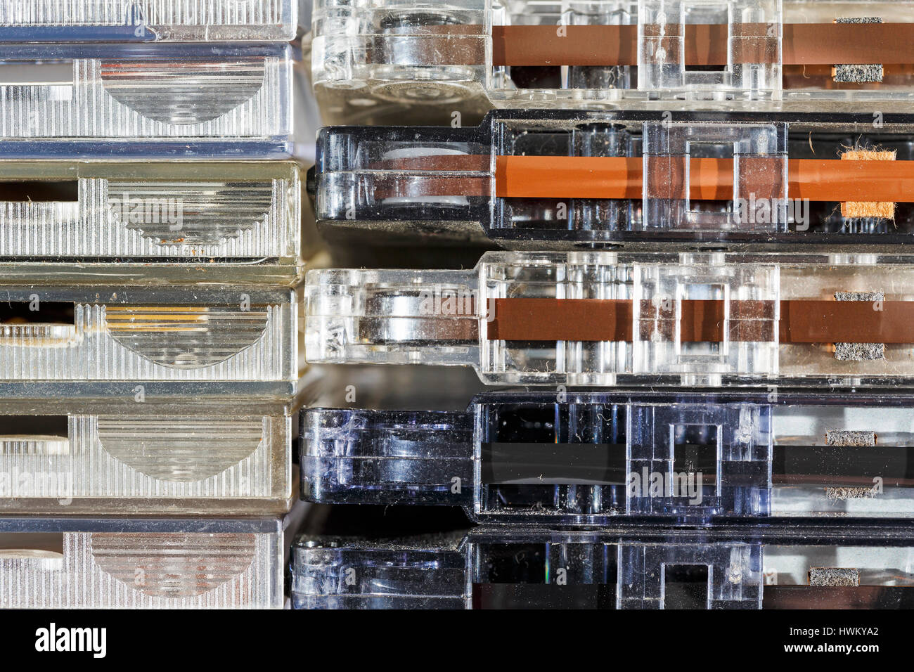 CD covers and Compact Cassettes arranged horizontally in a stack next to each other - Stock Image