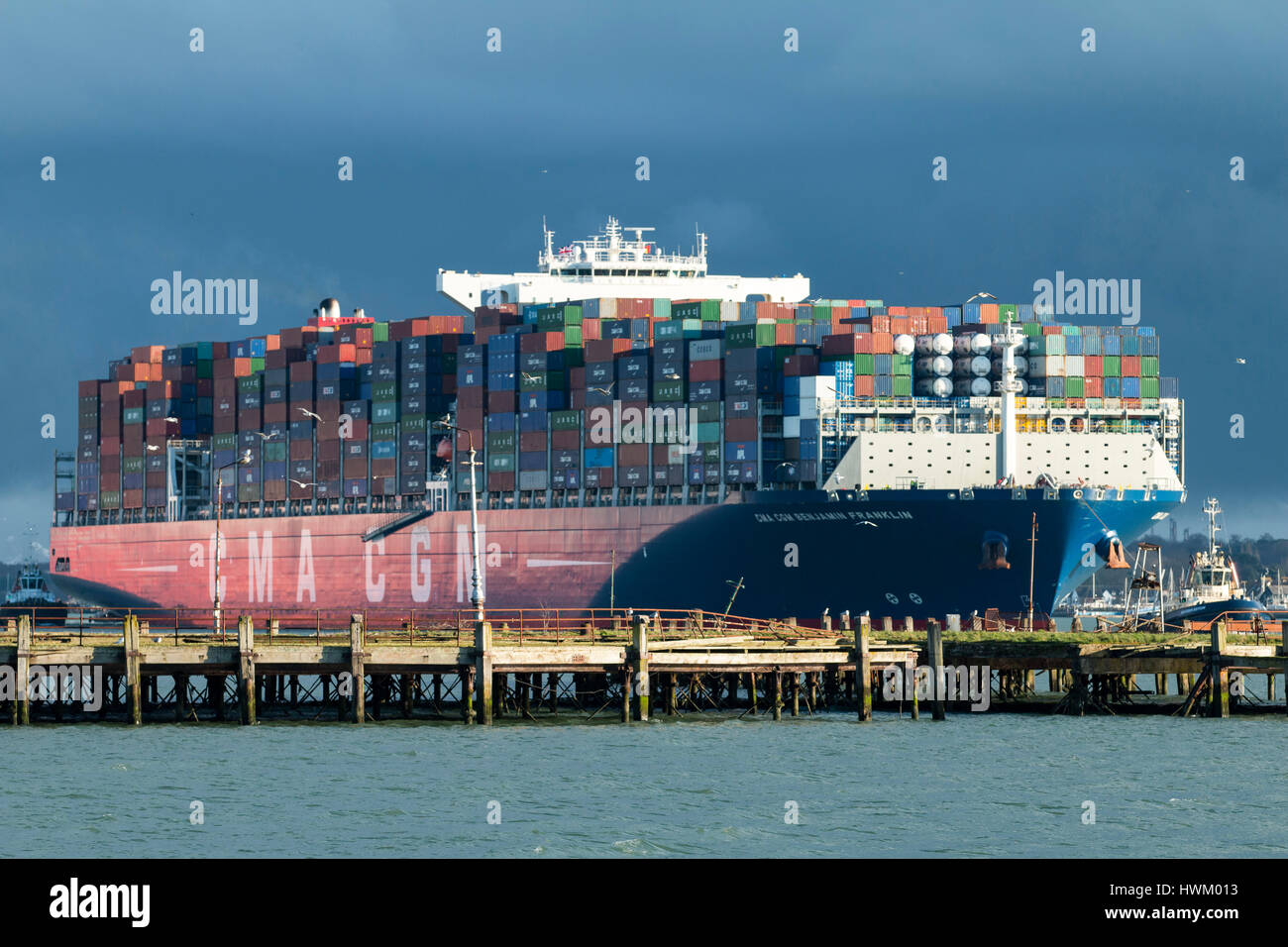 CMA CGM container ship Benjamin Franklin arriving at Southampton, UK  from Algeciras, Spain on 20 March 2017 attended - Stock Image