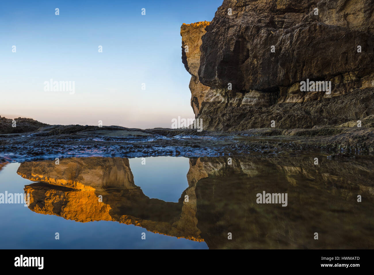 Gozo, Malta - Sunriseat the beautiful Azure Window, a natural arch and famous landmark on the island of Gozo with - Stock Image