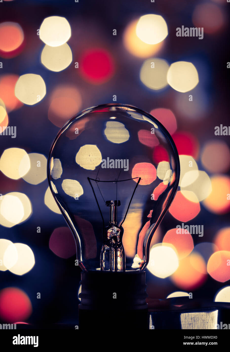 Light bulb bokeh. Abstract photo of a light bulb with colorful bokeh background. Stock Photo