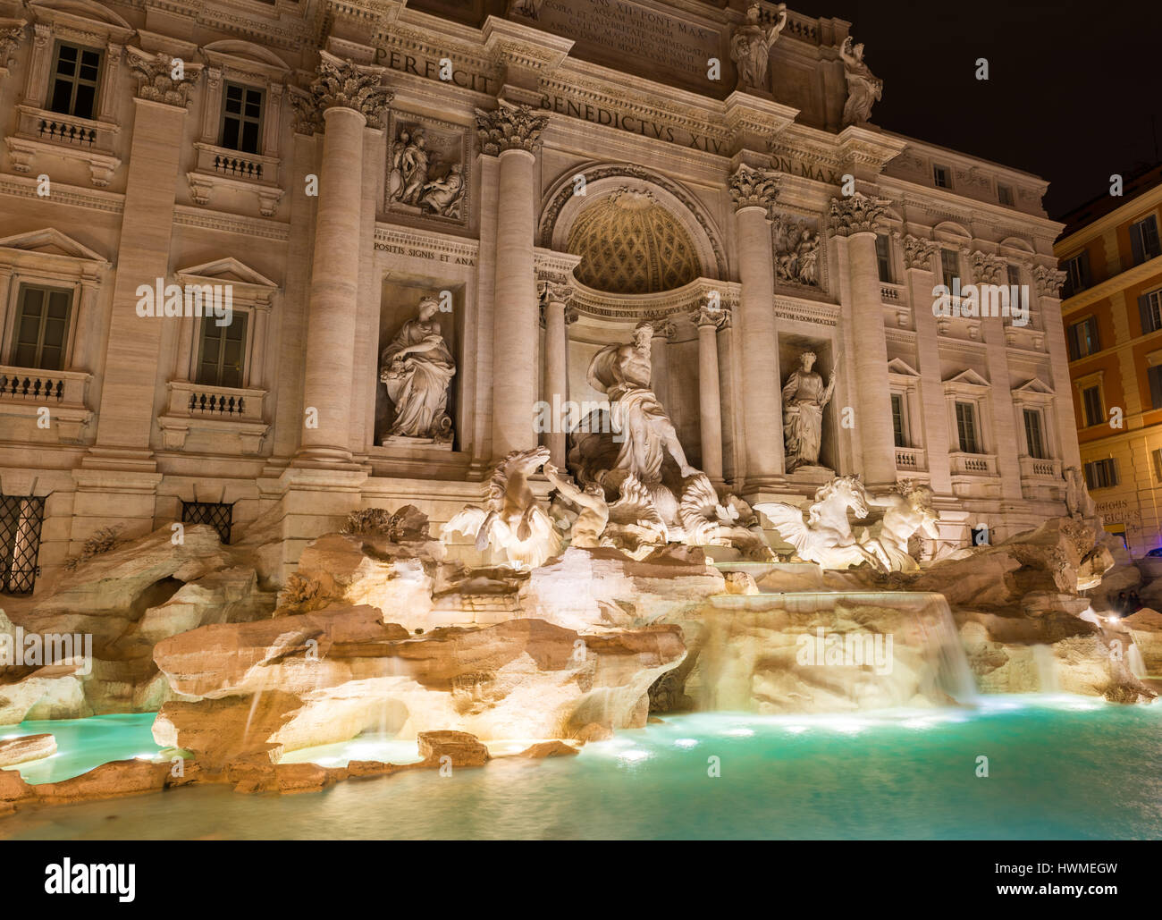 The Trevi Fountain  (Fontana di Trevi)  by night.  Pietro Bracci's statue, Oceanus (god of all water) is seen - Stock Image