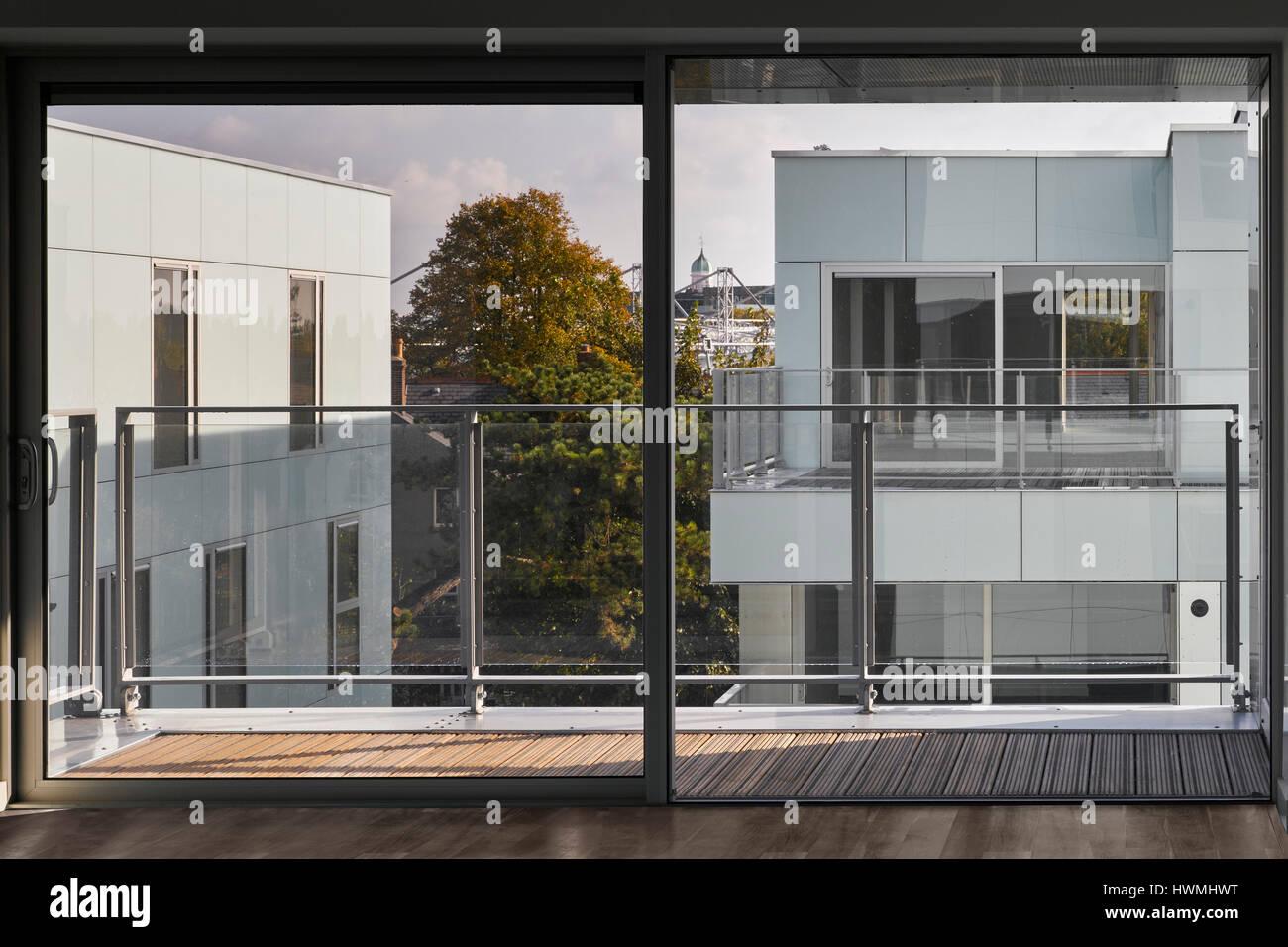 Interior View Of Third Floor Apartment Showing Glass Sliding Doors