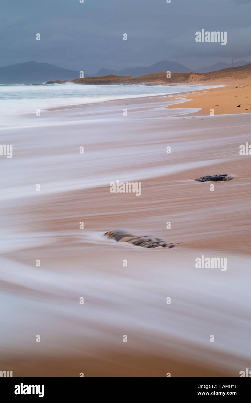 Beach foam at Borve, Isle of Harris - Stock Image