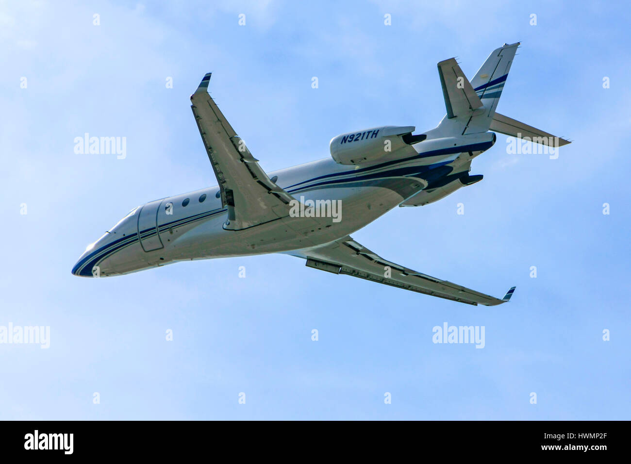 Galaxy G-200 personal executive jet over the skies of Sarasota SRQ airport in Florida Stock Photo