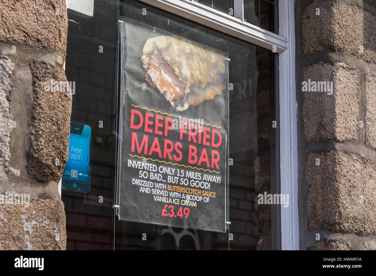Deep Fried Mars Bar advertising poster in the window of the Old Blackfriars pub in Aberdeen city centre, Scotland, - Stock Image