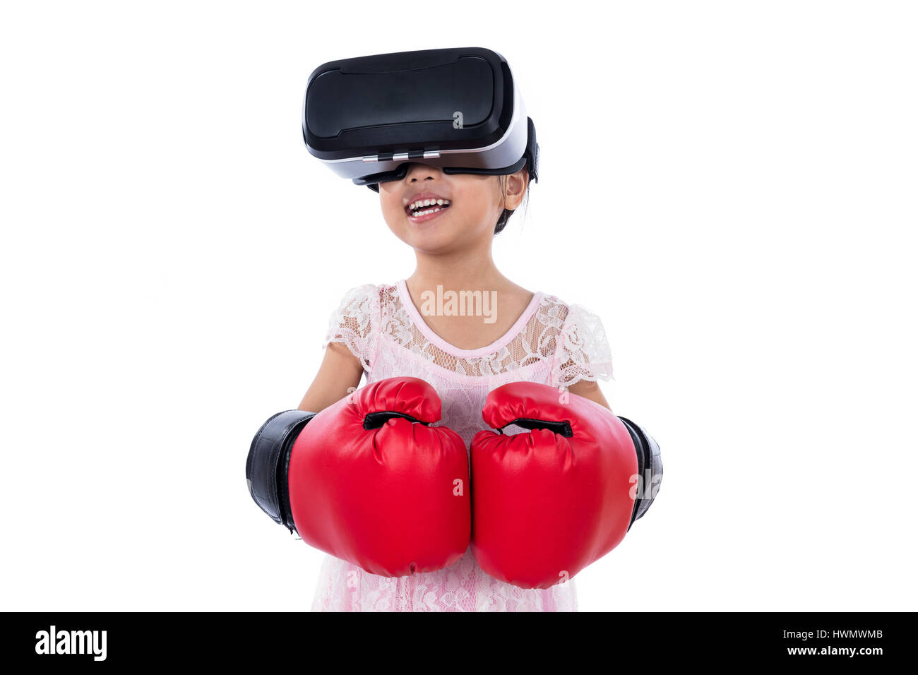 6e5b48cd7da6 Asian Chinese little girl experiencing virtual reality with boxing gloves  in isolated white background. -