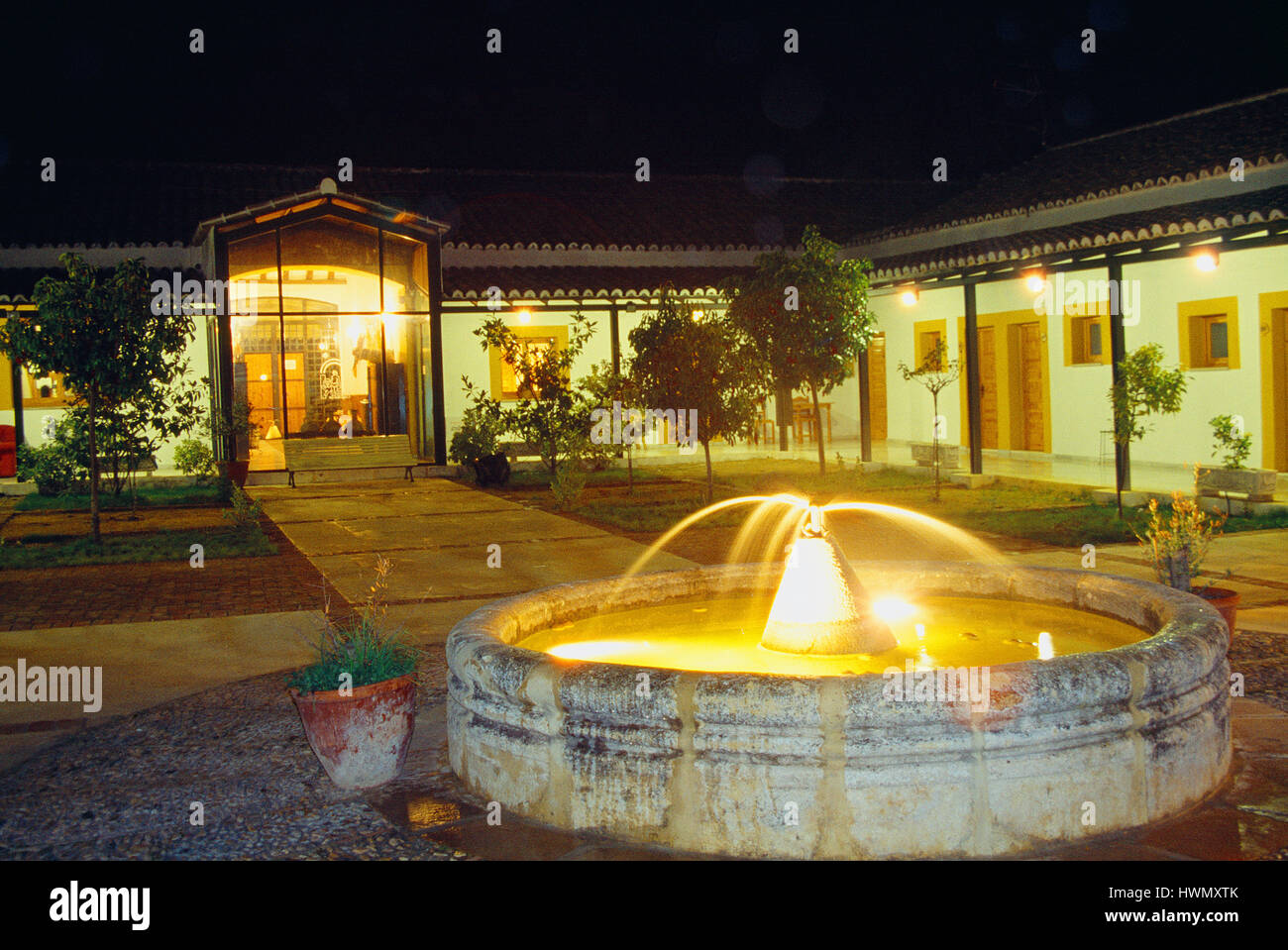 Courtyard of rural hotel, night view. Baena, Jaen province, Andalucia, Spain. - Stock Image