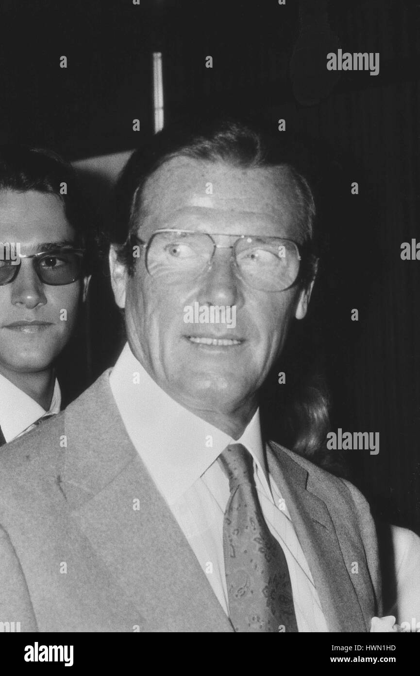 Roger Moore, British actor, attends a Variety Club luncheon in London, England on May 27, 1989. He is best known - Stock Image