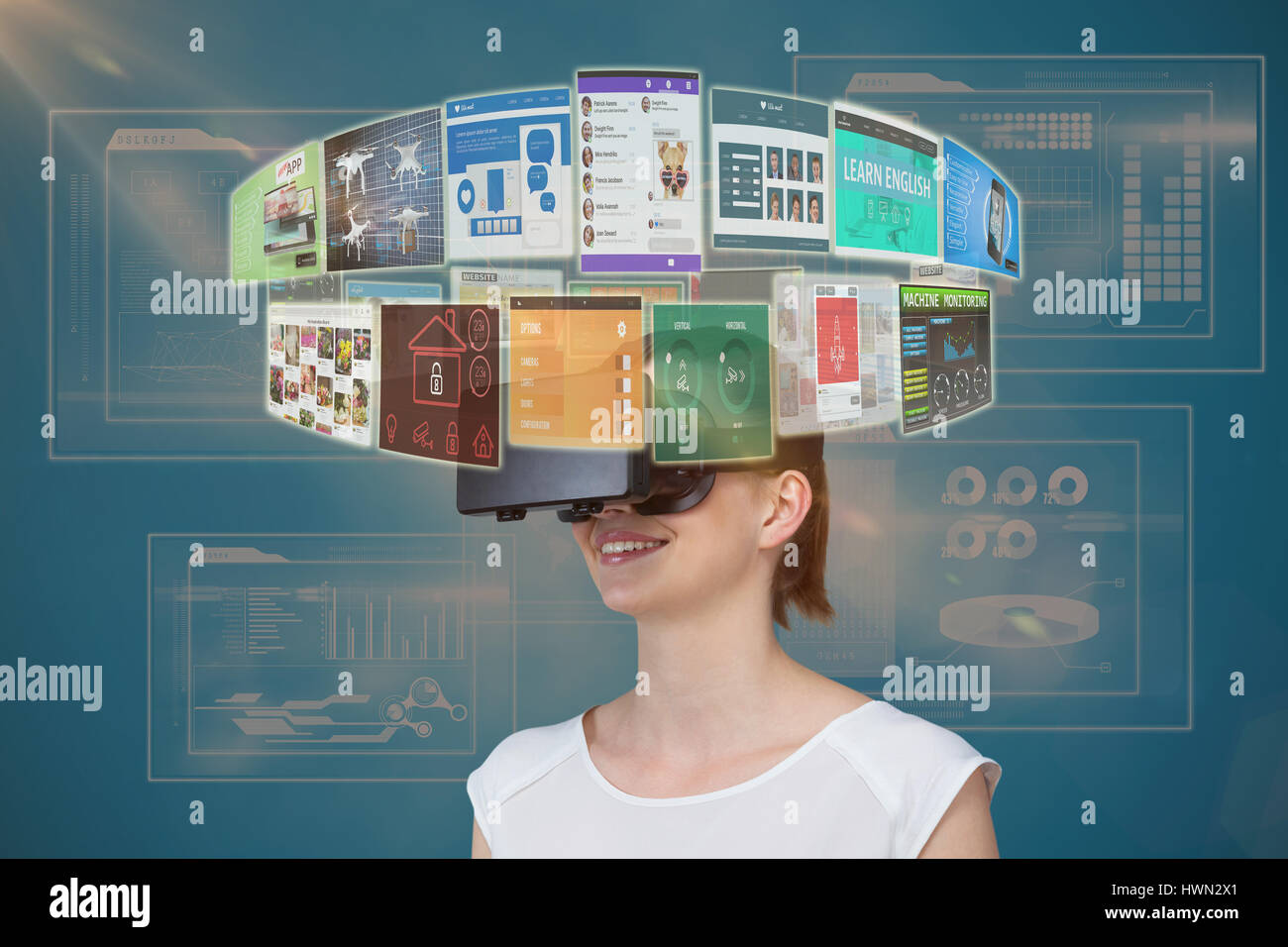 Happy woman experiencing virtual reality headset against business interface 3d - Stock Image