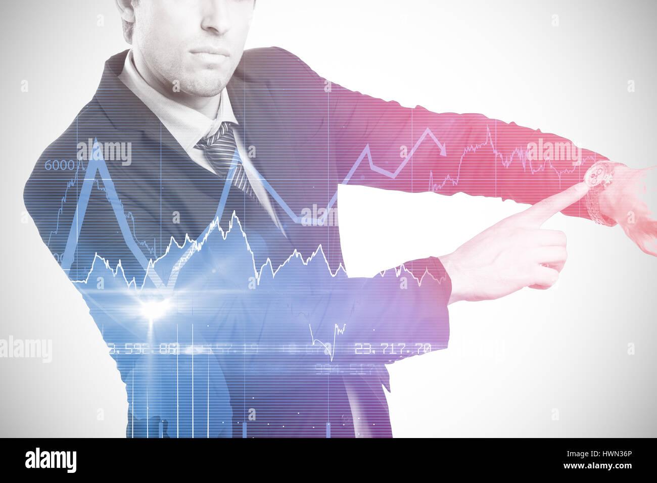 Portrait of serious businessman showing wristwatch against stocks and shares 3d Stock Photo