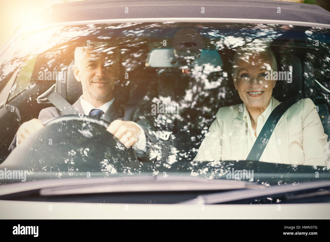 Couple in a car - Stock Image