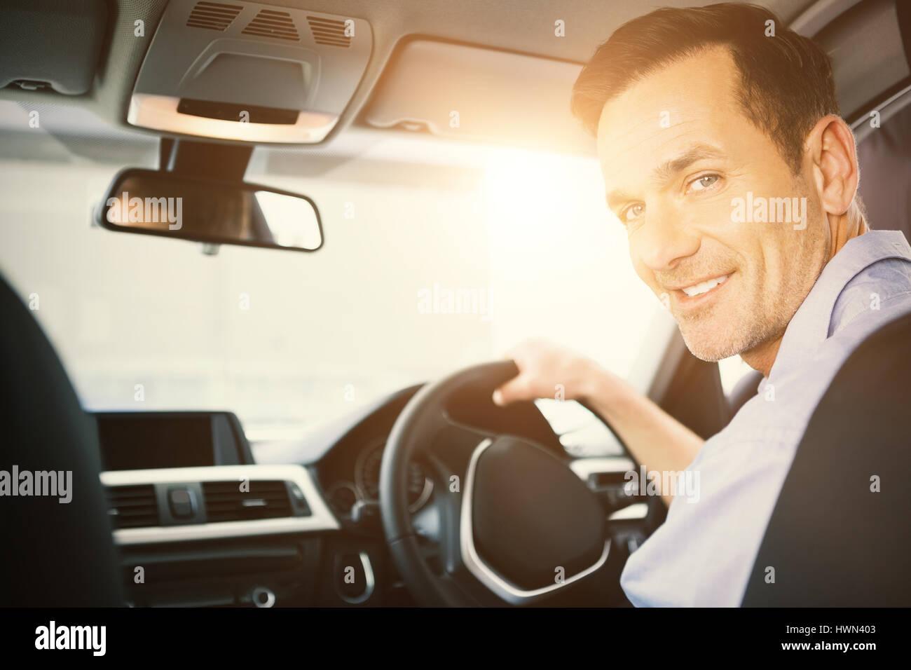 Men driving a car - Stock Image