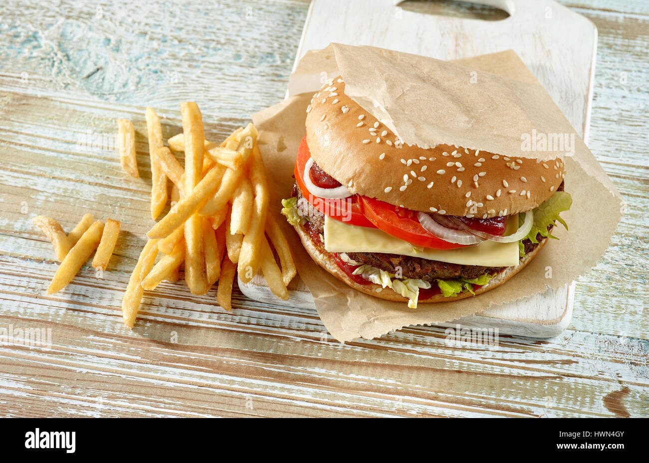 fresh tasty burger on wooden table - Stock Image