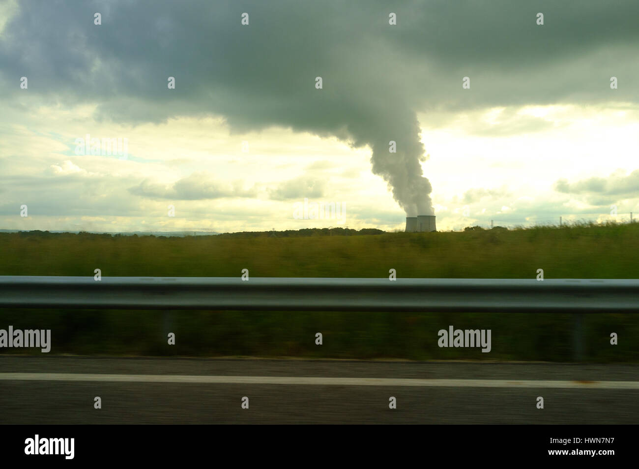 Smoking cooling towers of nuclear power plant, Centre-Val de Loire, France - Stock Image
