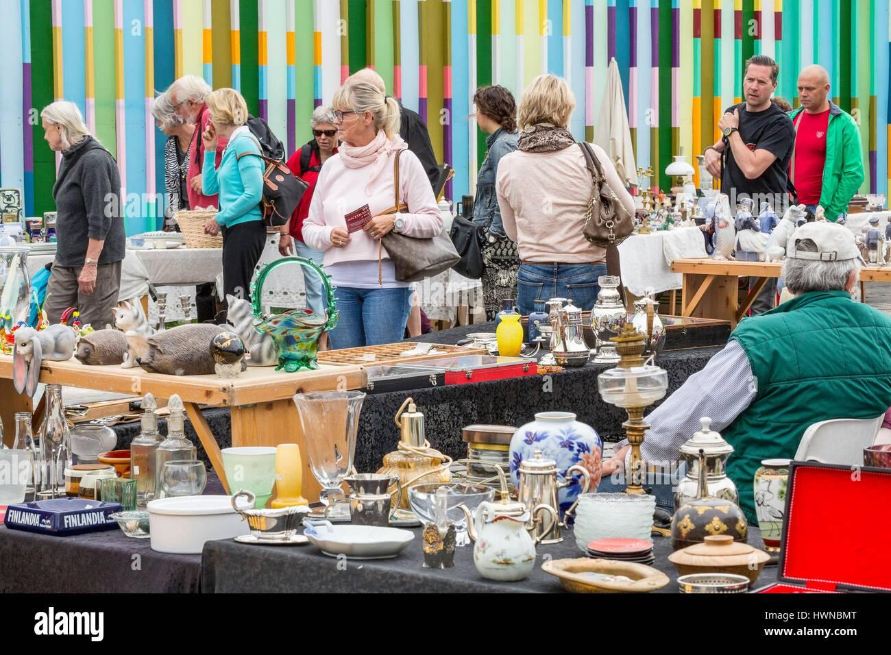 Denmark, Zealand, Copenhagen, Kongens Nytorv, flea market, stand against street art - Stock Image