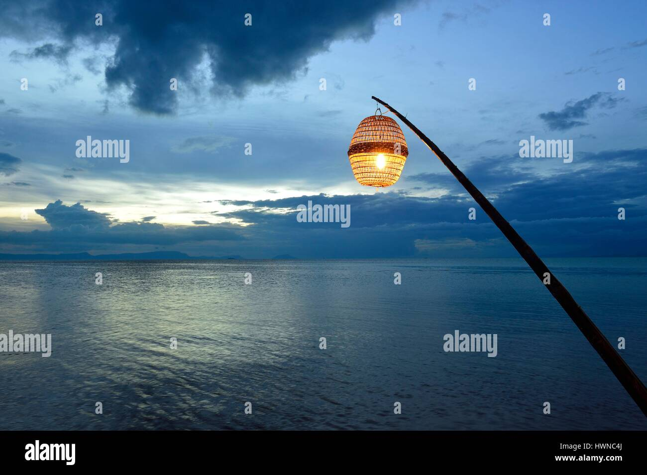 Cambodia, Krong Kep Province, Kep village, suspended lamp, sunset - Stock Image