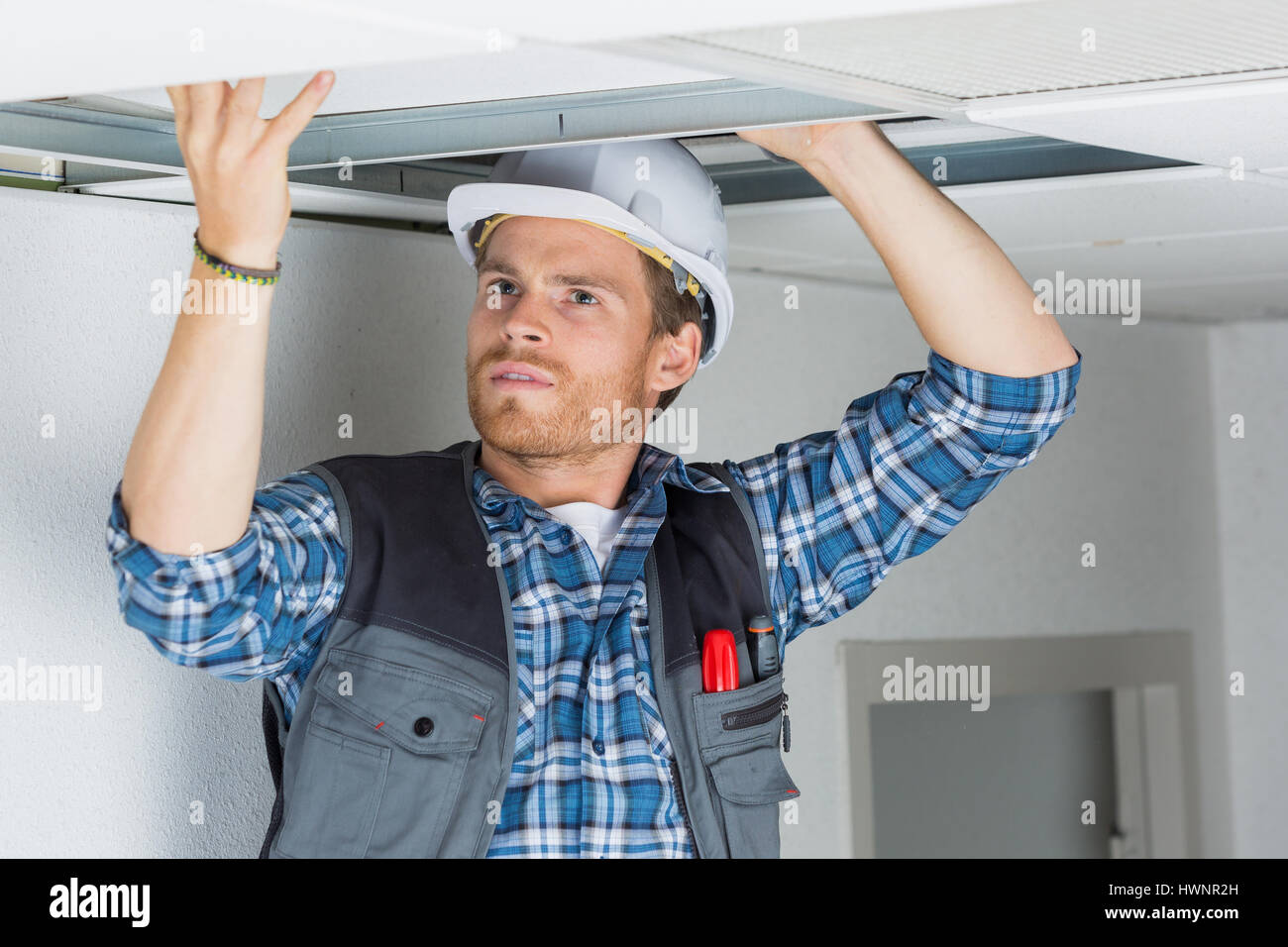 electrical worker wiring in ceiling Stock Photo: 136318073 - Alamy