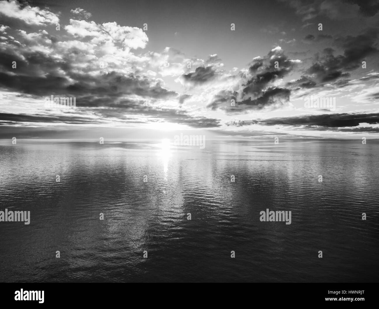 Black and white sunset over water aerial landscape - Stock Image