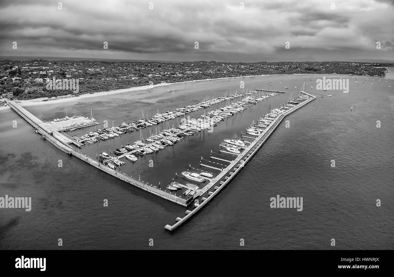 Black and white aerial view of Blairgowrie Marina on Mornington Peninsula, Melbourne Australia - Stock Image