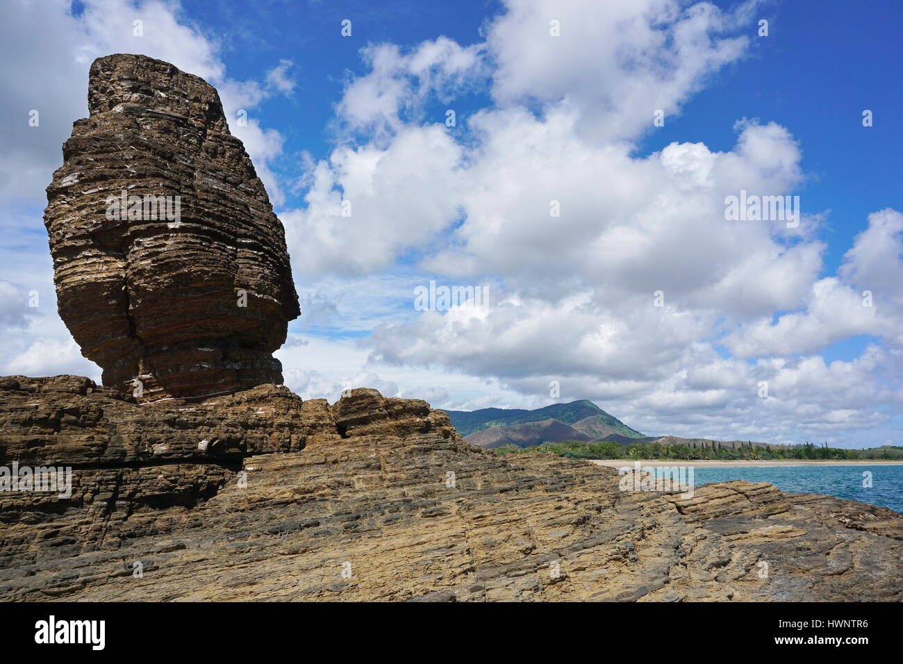 Rock formation on the seashore, the Bonhomme of Bourail, New Caledonia, Grande Terre island, south Pacific - Stock Image