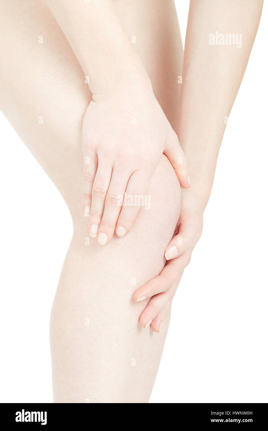 Woman knee pain with hands touching leg on white, clipping path - Stock Image