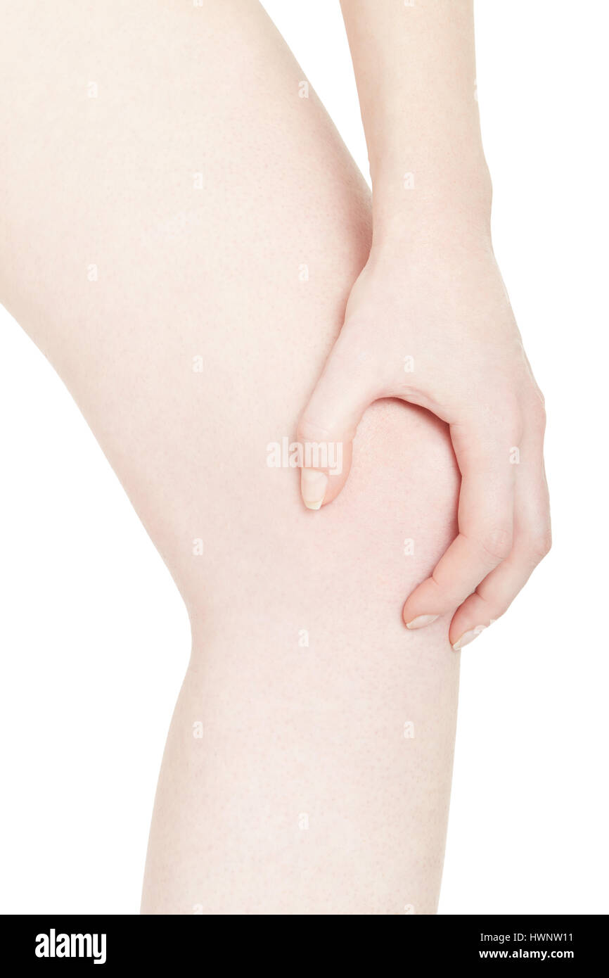Young woman hand holding her painful knee isolated on white, clipping path Stock Photo