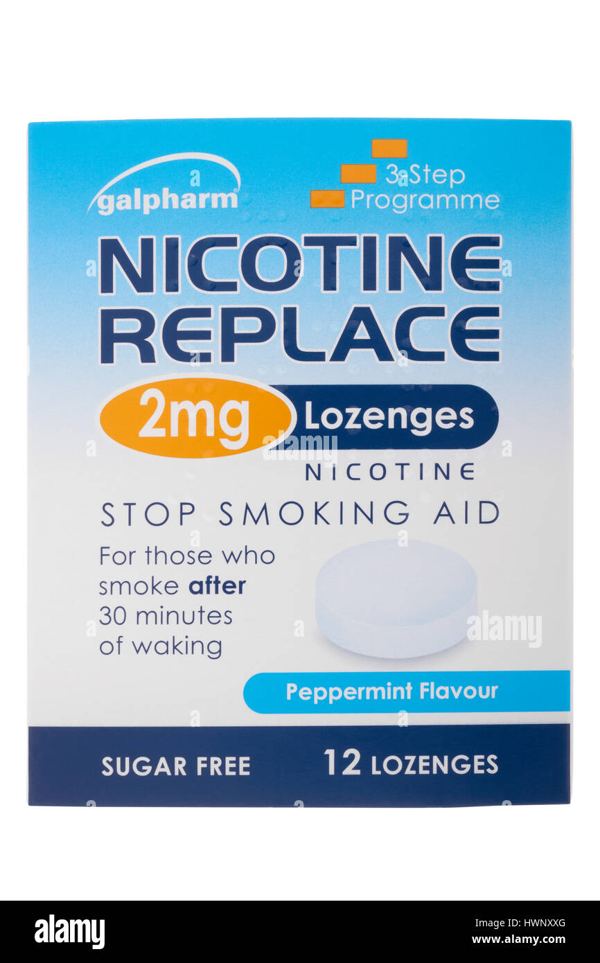 Box of nicotine replacement lozenges on white background - Stock Image