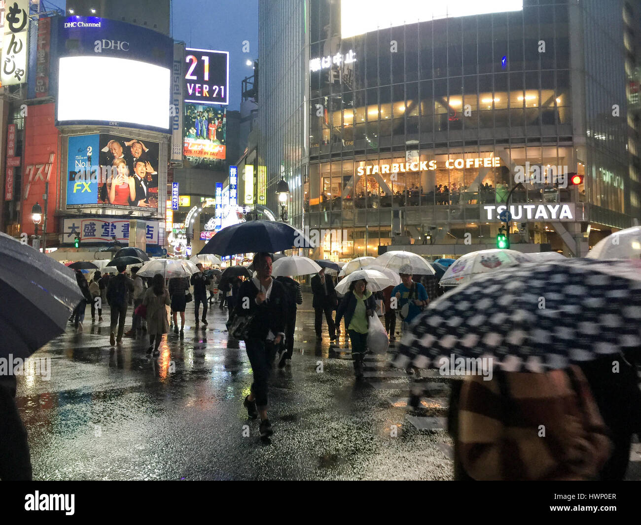 TOKYO - NOVEMBER 18, 2015: Pedestrians walk across the Shibuya junction on a rainy day on November 18, 2015 in Tokyo, Stock Photo