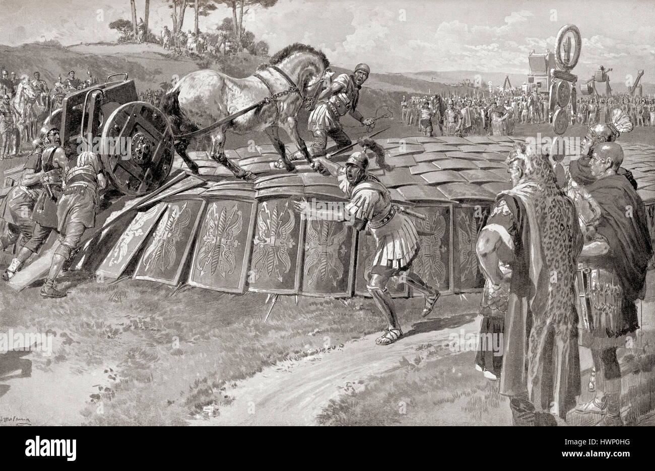 A Roman military exercise in the days of Julius Caesar, testing the Testudo - a military chariot being driven onto - Stock Image
