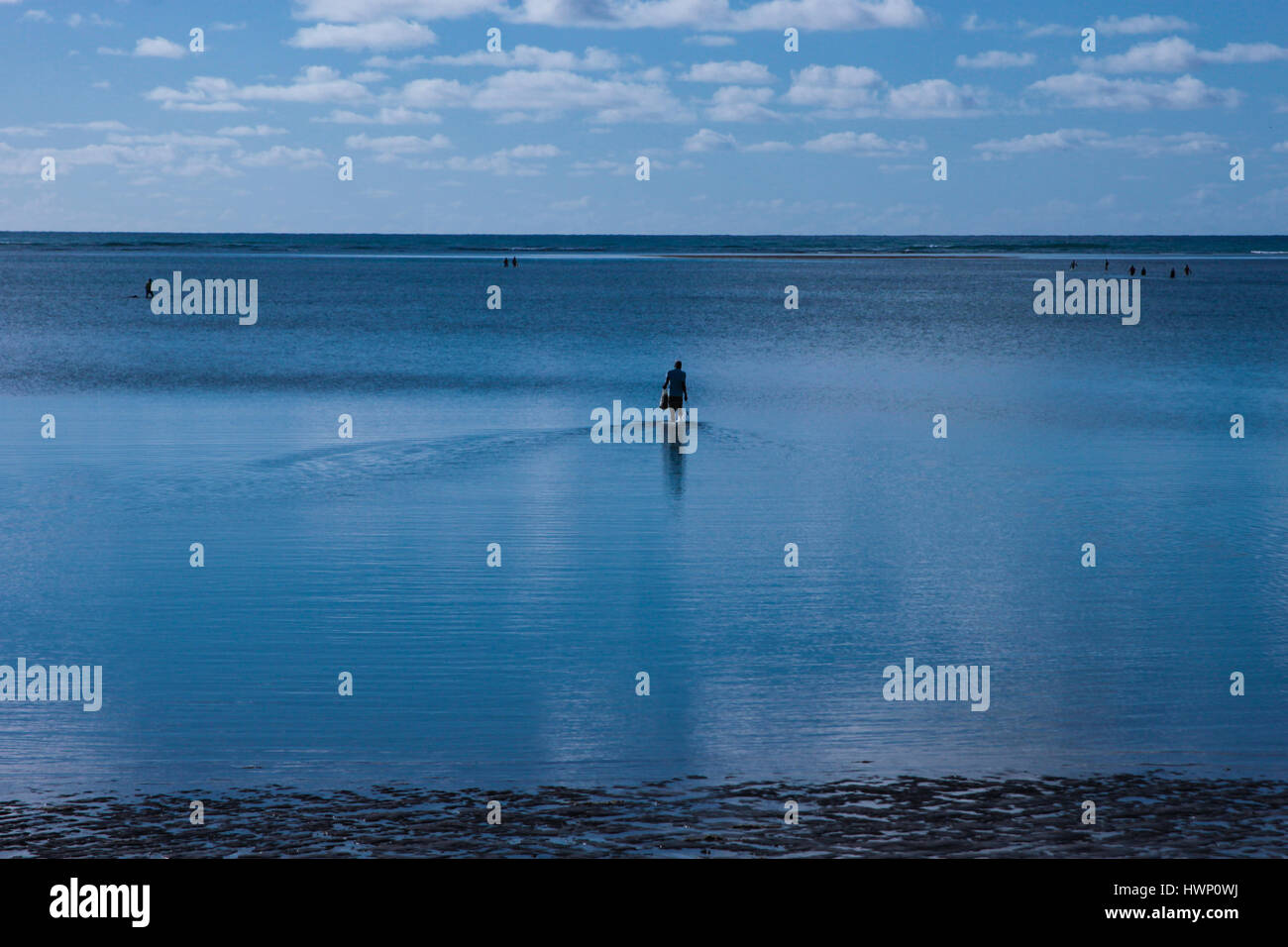 Beach Vacations: Patacho Beach, Alagoas, Brazil, considered one of the most beautiful beaches in Brazil- Fisherman in the background. Stock Photo
