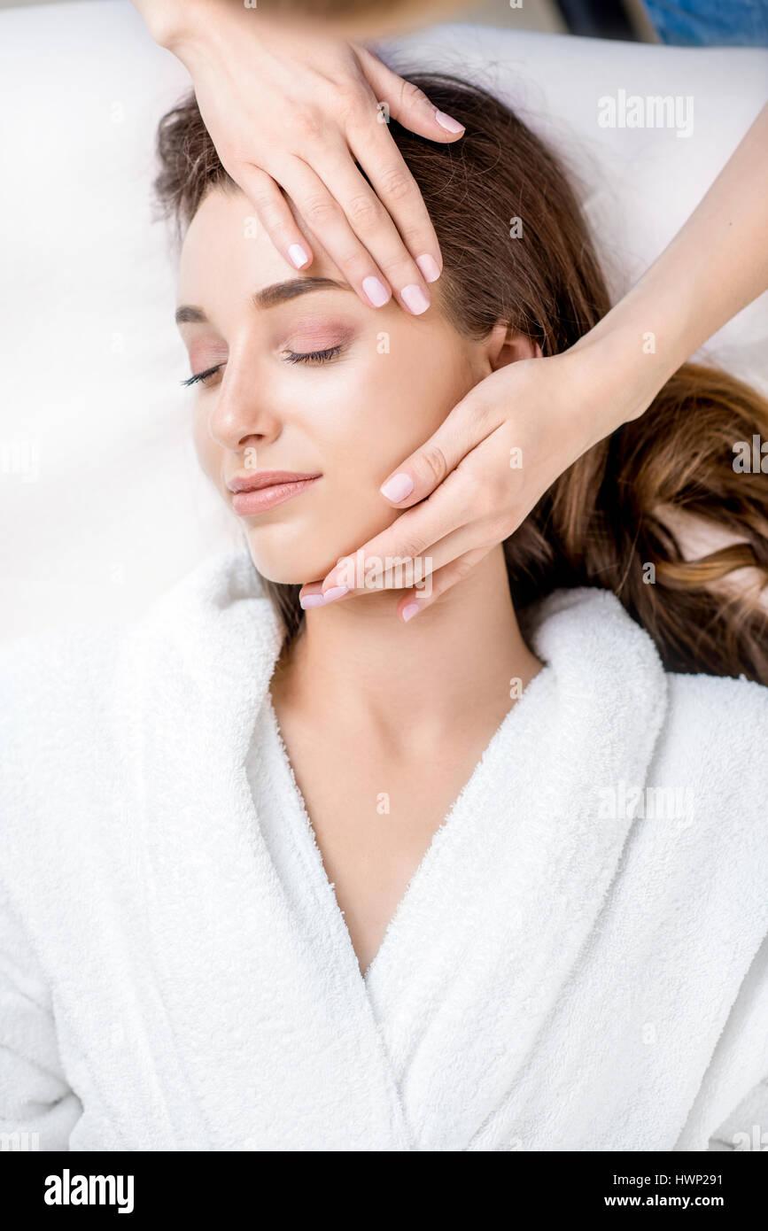 Woman getting facial massage - Stock Image